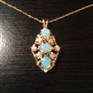 Jewelry - 14 k Gold chain and Opal pendant.